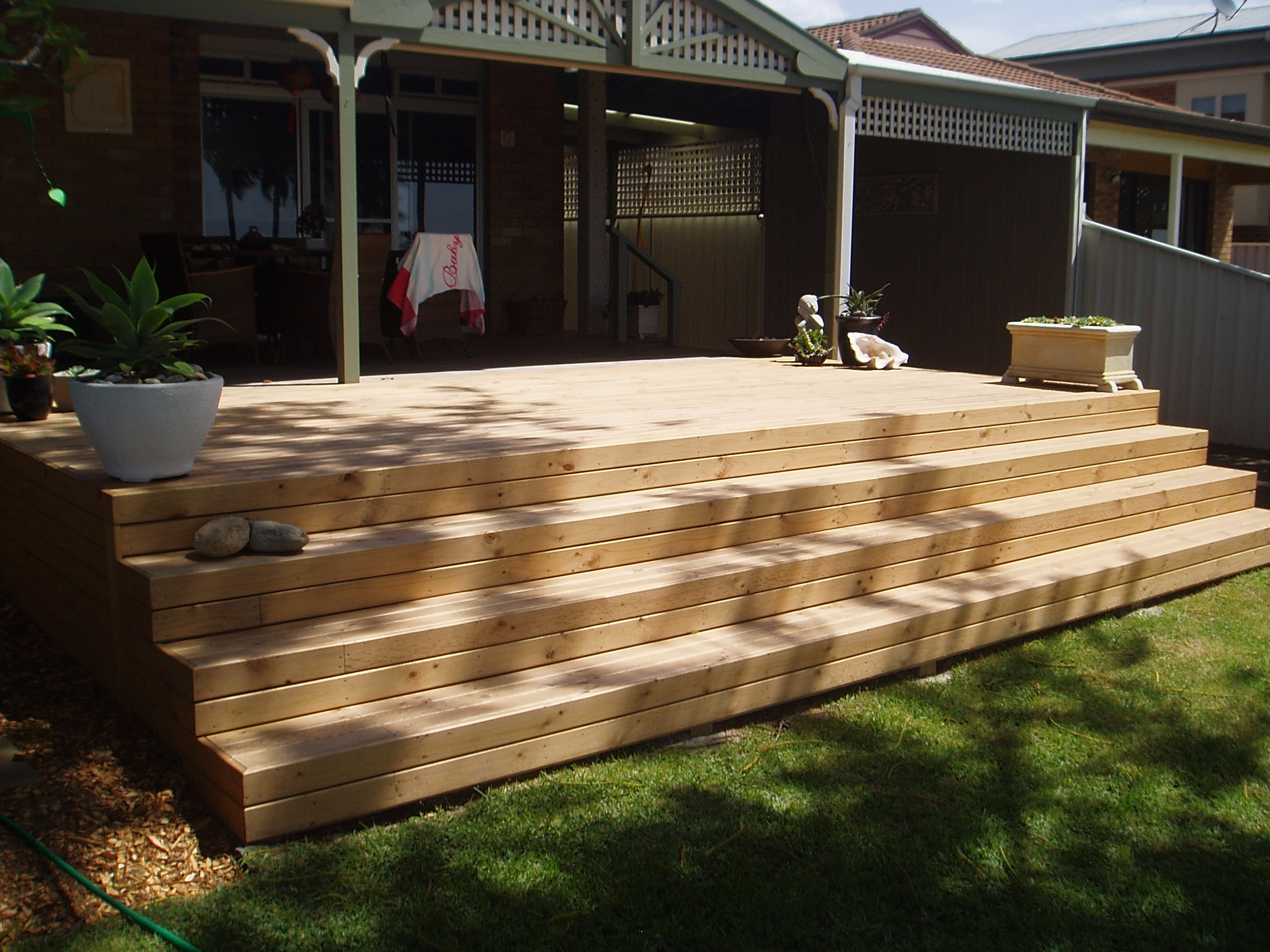 Hardwood and treated pine steps branson building material for Timber decking materials